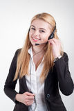 Beautiful blond business woman with headset Stock Images