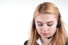 Beautiful blond business woman with headset Stock Photo