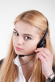 Beautiful blond business woman with headset Stock Image