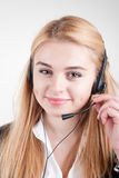 Beautiful blond business woman with headset Royalty Free Stock Photos