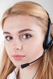 Beautiful blond business woman with headset Royalty Free Stock Photography