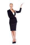 Beautiful blond business woman presenting copy space Royalty Free Stock Photography