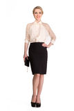 Beautiful blond Business Woman in white blouse and black skirt isolated on white Royalty Free Stock Photos