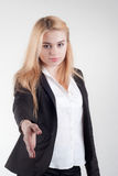 Beautiful blond businesswoman offering her hand in a handshake Royalty Free Stock Images