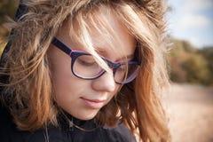 Beautiful blond Caucasian teenage girl in glasses Royalty Free Stock Photos