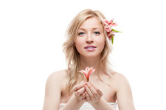 Blond girl with flower Stock Photos