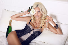 Beautiful blond with champagne Stock Image