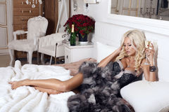 Beautiful blond with champagne Royalty Free Stock Photography