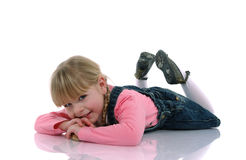Beautiful blond child 2. Beautiful blond child with braids and pink dress sitting on the floor Stock Photos