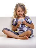 Beautiful blond child girl using mobile phone Royalty Free Stock Image