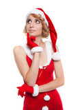 Beautiful blond christmas girl thinking and smiling - isolated o Royalty Free Stock Photo