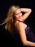 Beautiful blond dancing girl Stock Images