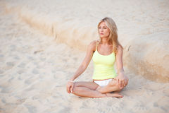 Beautiful blond european professional model girl sitting on Royalty Free Stock Images