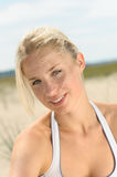 Beautiful blond female on the beach Stock Photos