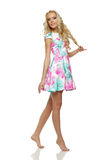 Beautiful blond female in full length standing in summer dress Royalty Free Stock Photo