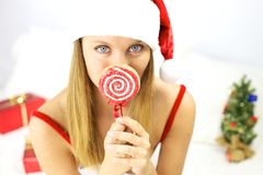Beautiful blond female santa claus with lollipop Stock Images