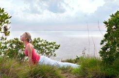 Beautiful blond female workout on the beach Royalty Free Stock Photography