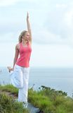 Beautiful blond female workout on the beach Stock Photos