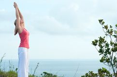 Beautiful blond female workout on the beach Royalty Free Stock Image