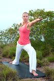 Beautiful blond female workout on the beach Royalty Free Stock Images