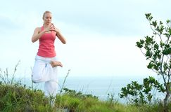 Beautiful blond female workout on the beach Stock Images