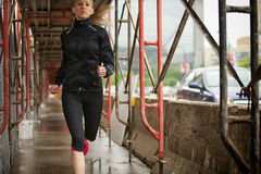 Beautiful blond fitness runner Royalty Free Stock Image