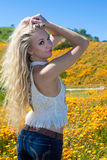 Beautiful blond in flower field Stock Photos