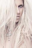 Beautiful blond girl. Portrait beautiful blond girl, jewel cross Royalty Free Stock Photo