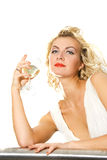 Beautiful blond girl. With a glass of champagne isolated on white Stock Images
