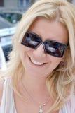 Beautiful blond girl. Smiling royalty free stock image