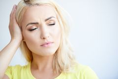 Beautiful blond girl with a bad headache Stock Photo