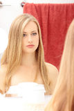 The beautiful blond girl in a bathroom Royalty Free Stock Images