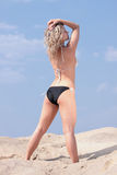 Beautiful blond girl in bikini taking sunbath Stock Photos