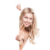 Beautiful blond smiling girl with a billboard Stock Image
