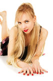 Beautiful blond girl in a black dress lying on the floor Royalty Free Stock Images