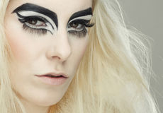 Beautiful blond girl with cat eyes make-up. In black and white Stock Photography
