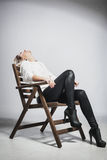 Beautiful blond girl on a chair Royalty Free Stock Image