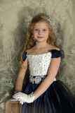 Beautiful blond girl child in a smart dress Royalty Free Stock Photos