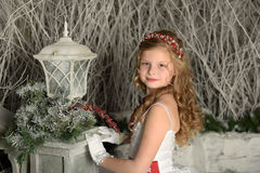 Beautiful blond girl child in a smart white dress Royalty Free Stock Photos
