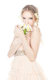 Beautiful blond girl with colorful daisies Royalty Free Stock Image