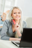 Beautiful blond girl with a credit card Stock Image