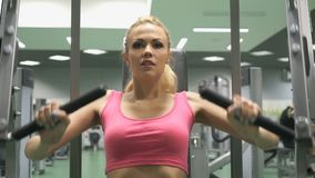 Beautiful blond girl engaged in the gym indoors stock video
