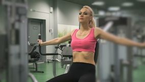Beautiful blond girl engaged in the gym indoors stock video footage