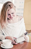Beautiful blond girl enjoying reading Stock Photo