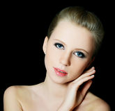 The beautiful blond girl with Evening make-up Royalty Free Stock Images