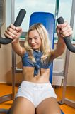 Beautiful blond girl exercising Royalty Free Stock Images