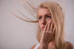 Beautiful blond girl expresses different emotions Stock Image
