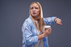 Beautiful blond girl feeling nervous about being late royalty free stock photos