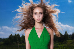 Beautiful blond girl on the field in forest Royalty Free Stock Images
