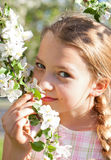 Beautiful blond girl in garden Royalty Free Stock Photos